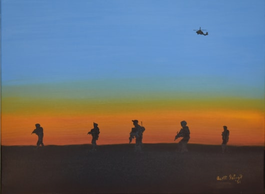 Soldier silouhettes patrolling at sunset with a helicopter flying in the distance.